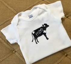 This onesie is part of the Farm Animal Collection. This is a white onesie with a black and white spotted cow and the sound they make :) Baby Boy Outfits, Kids Outfits, Cow Baby Showers, Baby Pigs, Pet Clothes, Future Baby, Children Clothing, Kids Fashion, Onesies