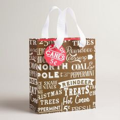 One of my favorite discoveries at WorldMarket.com: Small Retro Santa Signs Gift Bags, Set of 2