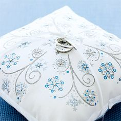 Don't know if your having a ring bearer, but I can make a pillow similar to this for you out of any fabric and ribbon you want. I would say I could make it for $5-$10 depending on the size.