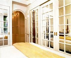I adore the way these mirrored French door closet doors look. They truly create the illusion of space in a small room. :)