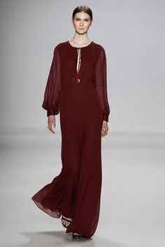 This design by Erin Fetherston for Fall 2015 is similar to a jumper/romper that you would see in the 1980s. Elements that compare between the two includes the dark, maroon color. Furthermore, the flare of the pant part of the romper and the wide sleeves create that 80s look. 4/1/2015