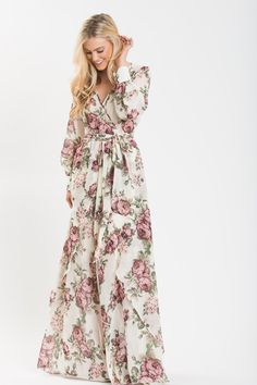 Our favorite floral maxi dress now comes in a gorgeous cream floral print! The unlined top and lightweight fabric covers you up without weighing you down! We're obsessed with the fit and flow of this