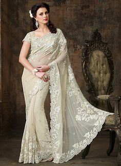 Charming beige patch border enhanced net saree with resham embroidered decorative patterns accentuate the rich look of the saree. Description from kesartrendz.com. I searched for this on bing.com/images