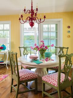 Cute Living Room and Dining Room. For inspiration, they turned to the Dorothy Draper--designed interiors of The Grand Hotel on nearby Mackinac Island. The landmark& whimsical, multicolor rooms struck a chord with the Borisches. Yellow Walls Living Room, Living Rooms, Yellow Dining Room, Estilo Shabby Chic, Dining Room Colors, Sweet Home, Cottage Interiors, Cottage Living, Coastal Living