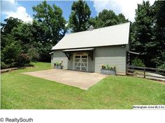 Fantastic party barn! Has floored upstairs for a game room, bathroom, heated and cooled, and workshop in the back!4516 Martin Wilson Rd, Trussville, AL 35173 -