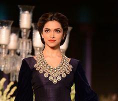 Deepika Padukone wearing gorgeous statement necklace walks the ramp for Manish Malhotra at the Delhi Couture Week 2013