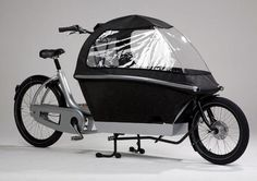 """Two Wheels for Babies and Breads Take a look at this bike which sets its sights on the future, one with real competitors to the automobile that sucks the life from the earth every day and night. This is the """"Urban Arrow,"""" a transport bike with electric pedal assistance, aluminum frame, and a box made ofsuper light EPP-material. It's green, they say it'll be affordable, it's comfortable, it's light enough to lift, and aesthetically, it's super fresh."""
