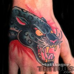 Panther tattoo on hand done at Think Tank Tattoo by Matt Sager Tank Tattoo, Denver Tattoo Artists, Tattoos Gallery, Panther, Skull, Panthers, Skulls, Sugar Skull, Black Panther