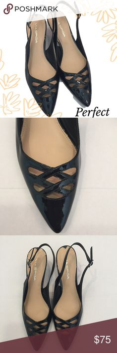 Via Spiga Black Kitty Heel Pump Beautiful kitty heel pump.  Only worn once.                                   Black patent leather, with beautiful front detail.  Pointed toe with sling back straps. Size: 7 N. Via Spiga Shoes Heels