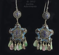 These are old Chinese export earrings dating from the 1920s,  Two sided silver filigree stars covered with enamel with a fringe of jade and rose quartz nuggets.  A tightly woven mesh is in the background with an overlay of twisted wire cells filled with enamel.  The earrings hang from a smaller matching silver enameled filigree beads with new sterling silver ear wires.  2--7/8  inches in length from the top of the ear wire to the bottom of the stone fringe.  the enameled star is 1 inch…