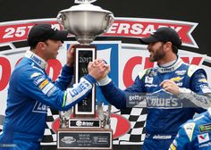 Jimmie Johnson, driver of the #48 Lowe's Chevrolet, and crew chief Chad Knaus celebrate after winning the Monster Energy NASCAR Cup Series Food City 500 at Bristol Motor Speedway on April 24, 2017 in Bristol, Tennessee.