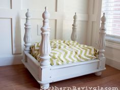 Can't you just imagine your four-legged princess curled up in this classic four-poster bed? Southern Revivals turned an broken end table upside-down and added finials to what used to be the legs to give it extra drama. Some round feet, a coat of white paint, and a chevron-patterned pillow complete the look. Get the tutorial at Southern Revivals.   - CountryLiving.com