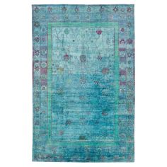 Mediterranean Blue Aura Silk Rug. I'd hang it on the wall before putting it on the floor...