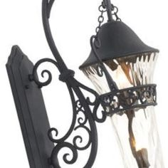 Outdoor wall lights set an architectural tone to a home both day and night...especially when they are well chosen to extend the classic details of a structure.  The Anastasia outdoor lights have lines and finishes reminiscent of a French historical chateau.  The elongated large fixture is a dramatic piece both day and night.  Post and hanging versions are also available.