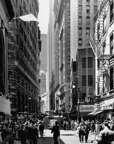 Andreas Feininger—Time & Life PicturesGetty Images -Pedestrians walk down Nassau Street past the Federal Reserve Building, The New York Stock Exchange can be glimpsed at the foot of the image. Downtown New York, New York City, Vintage New York, Lower Manhattan, Nassau, Street Photography, White Photography, Vintage Photos, Street View