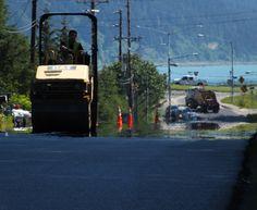 An hour after it was laid down, hot asphalt continues releasing heat. (Photo by Matt Miller/KTOO)