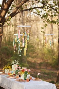I like the paper mobiles in this picture.  They could be fun if you make the drops with peacock feather colors.