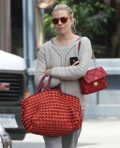 Sienna Miller was well coordinated while she was out and about in New York. She paired burnt orange sunglasses with a matching purse and bag. Sienna, you look stylish, so do us a favor and cheer up!