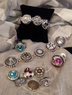 "New Gingersnap fashion jewelry.  Innerchangeable charms ""snap"" into bracelets, rings and necklaces."
