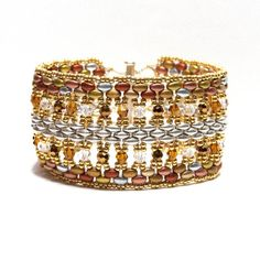 Use SuperDuos, twin beads and 4mm pearls, crystals or faceted beads and seed beads to create a sparkling cuff bracelet. PLEASE NOTE: The Adobe PDF file is now available as an IMMEDIATE download! The file size is approximately 9.2MB. The tutorial is comprehensive and clear (15 pages) and includes 49 clear colour photographs. I would advise that this is an easy to intermediate pattern for you to follow. For those of you who are beginners it would be an intermediate level, but very do-able…