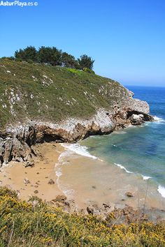 Western side of the Portiellu beach in Llanes, Asturias, Spain. More sand and more fun for you!