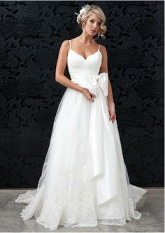 Custom made spaghetti straps wedding dress @Heather Creswell Davenport I thought you would like this
