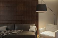 The young Ukrainian designer Svetlana Furman created a design of a living room in warm tones of wood and genuine leather, using wooden wall panels Pontelli.