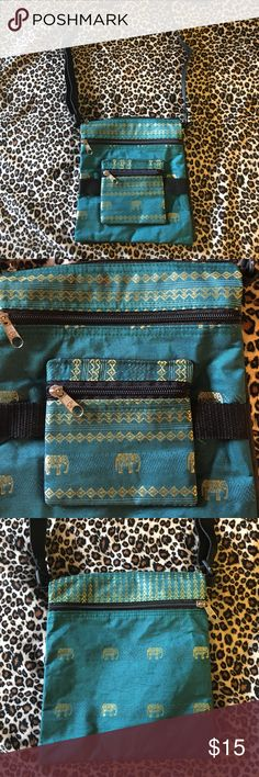 Cross-Body Elephant Print Bag Cute turquoise and gold elephant print cross body bag!  New condition, never used.  Perfect for travel or when you're out and about, the bag is folded in half with one large compartment accessed through top zipper that goes the entire length of the bag, separate zip pockets on front and back, and a smaller zip pocket on the front.  Adjustable black strap. Velcro closure keeps front and back together. Bags Crossbody Bags