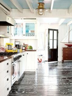 A black-and-white faux bois treatment looks almost too pretty to walk house design design and decoration interior decorators Kitchen Inspirations, Coastal Kitchen, Home, House Flooring, Kitchen Room, Cottage Room, Blue Ceilings, Home Kitchens, Beach House Flooring