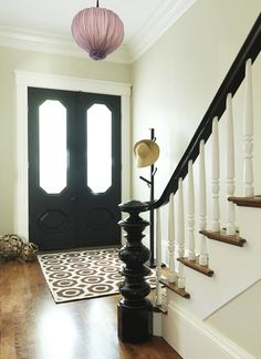 I haven't considered painting the inside of my front door black, but now I'm going to consider it.. & the railing :]