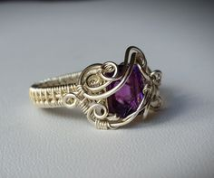 Sterling silver wire wrapped cushion cut Namibian Amethyst ring by Lepidus Plasmatio Wire Jewelry Rings, Wire Wrapped Jewelry, Metal Jewelry, Beaded Jewelry, Silver Jewelry, Craft Jewelry, Gold Jewellery, Jewlery, Do It Yourself Jewelry