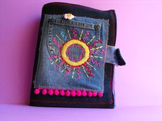 Riciclo creativo. Jeans book with many pages and many pockets
