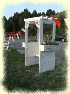 Built from old doors, vintage headboard and reclaimed wood for inside bench. Old shutters are used to build flower boxes for the sides, and iron brackets enhance the looks of the front awning.