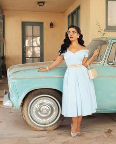 Lovely PinUp in light blue 50s dress