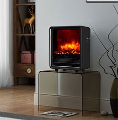 Don't know what kind of fireplace you could set up at home? Here are some design ideas you can inspire from to design the right fireplace for an impressive living room. Portable Electric Fireplace, Portable Electric Heaters, Electric Fireplace Heater, Portable Heater, Wall Mounted Fireplace, Metal Fireplace, Fireplace Design, Best Space Heater, Tabletop Fireplaces