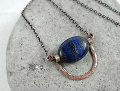 Lapis Lazuli necklace, September birthstone, Third Eye chakra stone, Protection & Inner Power Stone. This simple, elegant necklace was made with hand forged solid copper arch frame and beautiful, cobal blue Lapis Lazul gemstone bead, finished with a fine solid copper chain and a antique