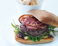 Donna Hay flavours her beef patties with garlic and parsley, then cooks them wrapped in pancetta for a tender finish. Serve with plenty of v...