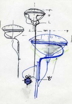 The Achille Castiglioni Toio Lamp.