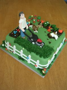 A cake for a man who recently started his own gardening company - a model of the man himself and of his two dogs with a flower bed and a vegetable garden too 21st Birthday Cake For Guys, 90th Birthday Cakes, Bithday Cake, 50th Cake, 70 Birthday, Allotment Cake, Vegetable Garden Cake, Bike Cakes, Dad Cake
