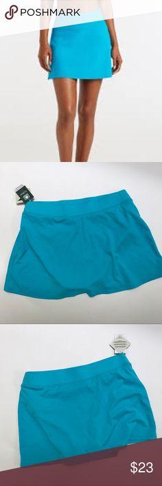 "LLBean cyan blue swim skort skirt LLBean cyan blue swim skort skirt NWT. Sun blocking swimwear UPF 50+. Lycra brand. Measured flat waist 14"", length 13"". Please let me know if you have any questions. L.L. Bean Swim Coverups"