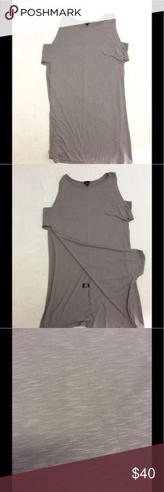 """2X TORRID side slit longline tank Brand: Torrid  Style: Side slit longline tank top Size: 2X  Approximate Measurements: pit to pit 20"""" (not really a defined pit area) shoulder to hem 41""""  Material: 96% polyester 4% spandex Features: Breaking news; we just found your wear-everyday, with-everything layering tank. The grey slub knit is flowy on its own, yet truly takes off with dramatic side slits that are held in place by entrance-making cage armholes. Minimal yet stunning. Condition…"""