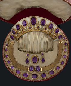 A beautiful early amethyst parure, 1790s, French. It's combe featuring nine large oval amethysts and eight smaller ones set into the filigree