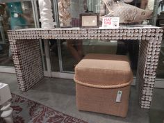A mosaic of hand-tumbled coconut tiles adorns this eye-catching console table by @jeffaninternat. #HATtag #atlmkt