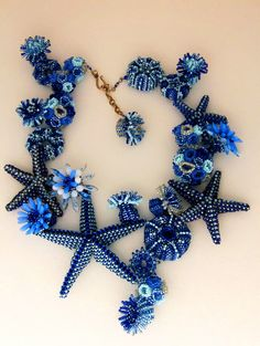 Beautiful floral beaded jewelry by Huib Petersen