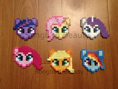 The ponies are made out of Perler Beads.    They measure approximately:      Twilight: 3 x 3  Fluttershy: 3 x 3  Rarity: 3.5 x 3  Pinkie Pie: 3.5