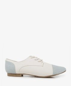 Canvas Oxfords featuring a colorblocked cap toe and shaft. Cord lace-up top. Padded insole. Textured outsole.