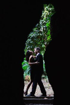 Fun pre-wedding photos captured in Rio de Janeiro. You can tell that the photographer must have coached the couple a little, for they are perfectly posed in between a rock structure that resembles a coke bottle and so naturally connect in front of the lens. Please note brides that great kissing, dips, and overall affection in front of the lens of a relative stranger can and should be practiced.