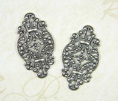 Antiqued Silver Ox Filigree Oval Connector by DecadentBrassGlass