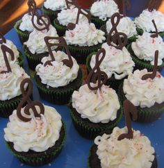 Or have them stand up like this??  Chocolate music note cupcakes :)