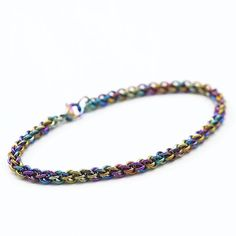 This kit contains all the materials you need to create this petite 20 gauge peacock colored bracelet! This bracelet features Peacock Rainbow Anodized Niobium hypoallergenic jump rings.. sweet and petite. A matching heart toggle clasp is the perfect finishing touch.  This will measures